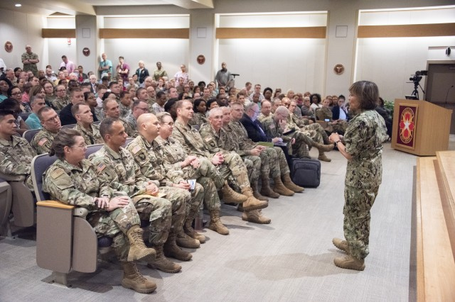 U.S. Navy Vice Adm. Raquel Bono, Defense Health Agency director, discusses the DHA transition during a town hall meeting at Brooke Army Medical Center, May 14, 2019. On Oct. 1, 2019 BAMC will transition under DHA command and authority.