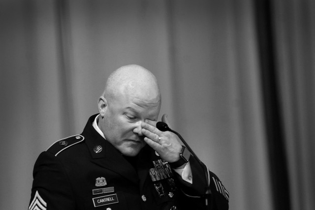 Sgt. Maj. Eric Cantrell, Petroleum and Water Department enlisted advisor, talks about his relationship with Col. Gregory Townsend before a capacity crowd at Memorial Chapel during Townsend's memorial service April 30.  Townsend died April 22 from injuries sustained during a April 18 car repair incident.