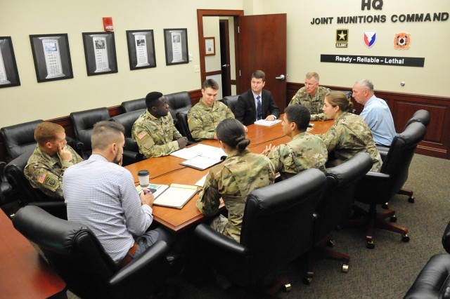 Five U.S. Military Academy senior year cadets and their academic advisor worked with Joint Munitions Command on a senior capstone project.  Here the team discuss the project with JMC leadership. (Photo credit: U.S. Military Academy)