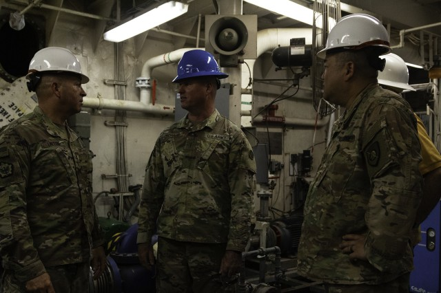 Chief Warrant Officer 2 Nate Layton, 393d Transportation Detachment, 129th Support Battalion, 300th Sustainment Brigade, Chief Warrant Officer 4 Jody Michaud, and Lt. Col. Jeremy Baran, 300th Sustainment Brigade deputy commanding officer, discuss the maintenance process of the engine room of logistics support vessel USAV SP4 James A. Loux (LSV-6) at Port of Shuwaikh, Kuwait, May 13, 2019. (U.S. Army Reserve photo by Capt. Jerry Duong)