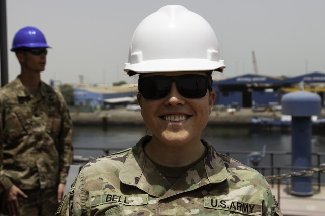 Capt. Kristen Bell, 393d Transportation Detachment commander, 129th Support Battalion, 300th Sustainment Brigade, takes a picture during the inspection of On-Condition Cyclic Maintenance of logistics support vessel USAV SP4 James A. Loux (LSV-6) at Port of Shuwaikh, Kuwait, May 13, 2019. (U.S. Army Reserve photo by Capt. Jerry Duong)