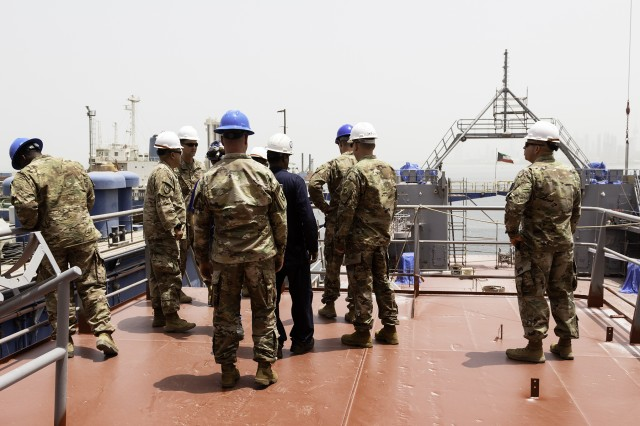 Leaders of the 300th Sustainment Brigade visit during On-Condition Cyclic Maintenance of logistics support vessel USAV SP4 James A. Loux (LSV-6) at Port of Shuwaikh, Kuwait, May 13, 2019. (U.S. Army Reserve photo by Capt. Jerry Duong)
