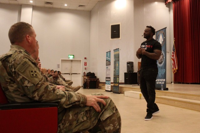 """Retired Army Chief Warrant Officer 3 Edward """"Obbie West"""" Wilson performs a poem describing what sexual assault is, during a Sexual Harassment/Assault Response & Prevention (SHARP) Spoken Word event at Camp Arifjan, Kuwait, May 10, 2019. (U.S. Army photo by Claudia LaMantia)"""