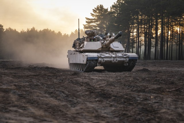 An M1A2 Abrams Tank from 1st Squadron, 4th Cavalry Regiment, 1st Armored Brigade Combat Team, 1st Infantry Division rolls out, as part of an Initial Ready Task Force (IRTF) exercise, at Johanna Range, Poland, May 20, 2019. An IRTF is similar to an Emergency Deployment Readiness Exercise (EDRE) but on a smaller scale. An IRTF is a no-notice, rapid-deployment exercise designed to test a unit's ability to alert, marshal, and deploy forces and equipment for contingency operations or an emergency disaster. (U.S. Army photo by Sgt. Thomas Mort)