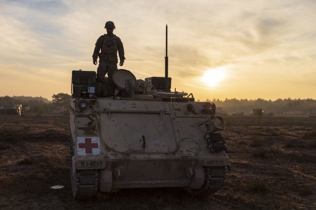 A Soldier from 1st Squadron, 4th Cavalry Regiment, 1st Armored Brigade Combat Team, 1st Infantry Division, prepares an M113 armored personnel carrier for a convoy, during an Initial Ready Task Force (IRTF) exercise, at Johanna Range, Poland, May 20, 2019. An IRTF is similar to an Emergency Deployment Readiness Exercise (EDRE) but on a smaller scale. An IRTF is a no-notice, rapid-deployment exercise designed to test a unit's ability to alert, marshal, and deploy forces and equipment for contingency operations or an emergency disaster. (U.S. Army photo by Sgt. Thomas Mort)