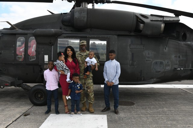 Newly promoted Capt. Eric S. Anderson Sr. (center), executive officer for the U.S. Army Health Clinic Hohenfels, is gathered with his, Shondra, and their five children, at the AHC Hohenfels Clinic Helipad, Hohenfels, Germany, May 17, 2019. Anderson was diagnosed with having chronic lymphocytic leukemia, or CLL, a type of cancer in which the bone marrow makes too many lymphocytes, a type of white blood cell. CLL is one of the most common types of leukemia in adults. Anderson, a native of Fort Worth, Texas, is being assigned as a patient at Brooke Army Medical Center Warrior Transition Battalion at Joint Base San Antonio-Fort Sam Houston, Texas. His family will accompany him to Texas. (U.S. Army photo by Alain M. Polynice)
