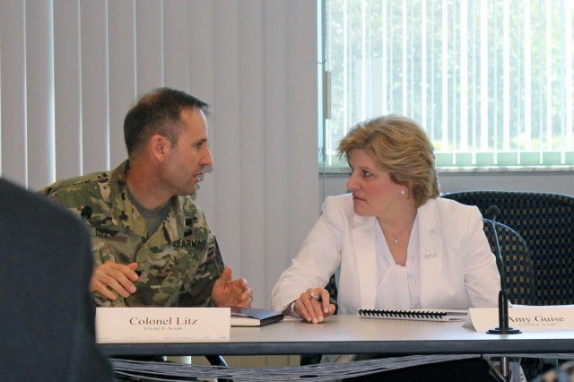 Col. John Litz, U.S. Army Corps of Engineers, Baltimore District, commander, and Amy Guise, Baltimore District Planning Division chief, have a discussion during the Commonwealth of Pennsylvania and U.S. Army Corps of Engineers Collaboration Workshop at the Rachel Carson Building in Harrisburg, Pennsylvania, May 16, 2019. (U.S. Army photo by Sarah Lazo)
