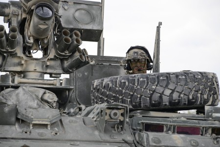 A U.S. Soldier assigned to 2nd Cavalry Regiment waits inside a Stryker armored vehicle after conducting a live fire exercise at 7th Army Training Command's Grafenwoehr Training Area, Germany, May, 7, 2019. The LFX was conducted in order to increase the 2nd Squadron's readiness prior to Saber Guardian  19 and Dragoon Ready 20.
