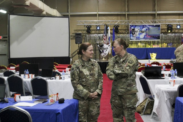 Command Sgt. Maj. Sheryl Lyon, U.S. Army Cyber Command senior enlisted leader (left), and Brig. Gen. Nikki Griffin Olive, commanding general of the 335th Signal Command (Theater) (Provisional) and U.S. Army Central (USARCENT) G-6, discuss USARCENT's 2019 Best Cyber Warrior Competition, at Camp Arifjan, Kuwait, May 16, 2019. The event was the first joint, multinational competition, and highlighted the need for commanders in all services and components to prioritize the defense the networks that underpin all military operations as they do any operational key terrain