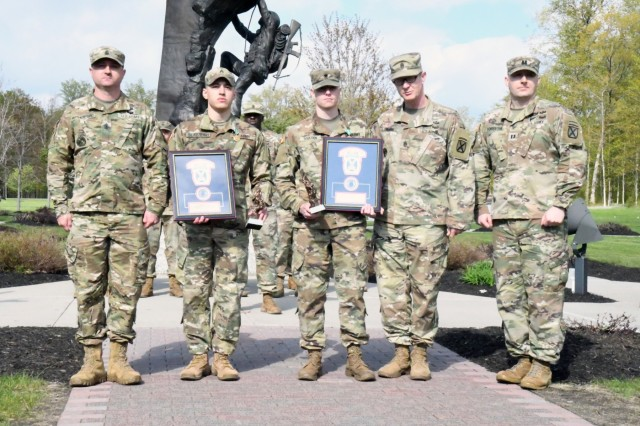 Cpl. Noah Slabaugh and Spc. Joel Boulden were named Noncommissioned Officer of the Year and Soldier of the Year, respectively, out of a pool of 11 finalists at the 10th Mountain Division's Best Warrior Competition. Both Soldiers serve with the 91st Military Police Battalion and were recognized during an awards presentation May 17 at Memorial Park. (Photo by Mike Strasser, Fort Drum Garrison Public Affairs)