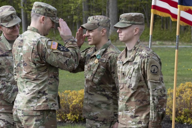 Capt. Austin Forsythe, Light Fighters School commander, salutes the winners of the 10th Mountain Division (LI) Best Warrior Competition during an awards ceremony May 17 at Memorial Park. Cpl. Noah Slabaugh and Spc. Joel Boulden were named Noncommissioned Officer of the Year and Soldier of the Year, respectively, out of a pool of 11 finalists at the competition. Both Soldiers serve with the 91st Military Police Battalion. (Photo by Pfc. Gregory Muenchow)