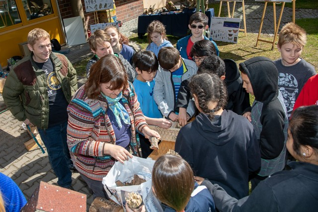 Sixth grade students gather materials outside of Patch Middle School to build bird and bat homes with USAG Stuttgart DPW Environmental Division's Inga Gebhard, May 15, 2019. Photo by Juergen Pfleiderer