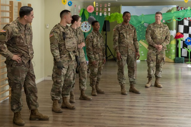 Soldiers of the Judge Advocate General shop, 1st Armored Brigade Combat Team, 1st Infantry Division, introduce themselves to to school children at at Lingualand, a bilingual kindergarten in Zielona Góra, Poland, during a visit to the school 8 May, 2019. The JAG soldiers visited the school and conversed with the children in English as part of a community relations opportunity hosted by the school. (U.S. Army photo by Sgt. Jeremiah Woods)