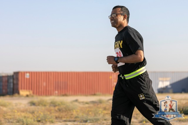 Staff Sgt. Zafar Iqbal, 184th Sustainment Command, runs in the Arifjan Marathon at Camp Arifjan, Kuwait, April 14, 2019.