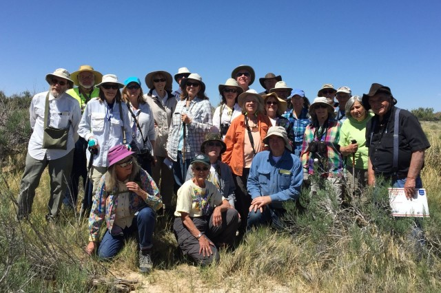 The Native Plant Society of New Mexico Albuquerque Chapter assembles for a group photo at Malpais Spring with their guide for the day, Dave Anderson.