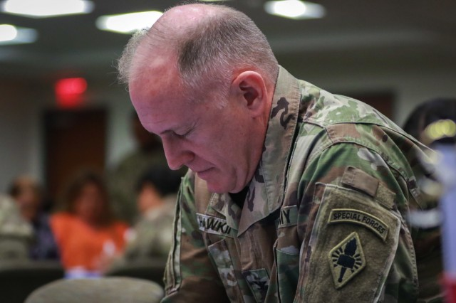Chaplain (Col.) Jeffrey D. Hawkins, commandant for the U.S. Army Chaplain Center and School, joins the audience in prayer during the National Day of Prayer luncheon at U.S. Army Central headquarters on Shaw Air Force Base, S.C., May 2, 2019. (U.S. Army photo by Sgt. Von Marie Donato)