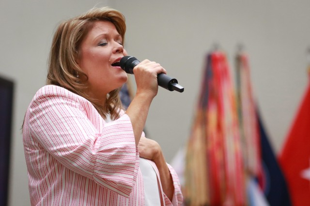 Emily Martuscelli, a vocalist from Alice Drive Baptist Church in Sumter, South Carolina, sings a worship song during the National Day of Prayer luncheon at U.S. Army Central headquarters on Shaw Air Force Base, S.C., May 2, 2019. (U.S. Army photo by Sgt. Von Marie Donato)
