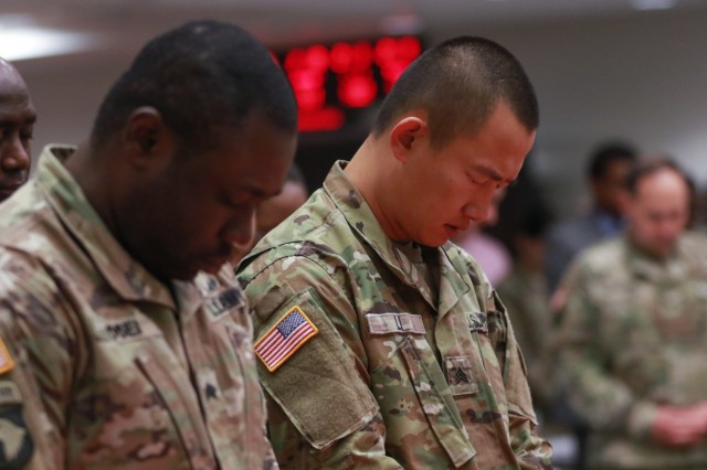 Soldiers from U.S. Army Central join in prayer during the National Day of Prayer luncheon at USARCENT headquarters on Shaw Air Force Base, S.C., May 2, 2019. (U.S. Army photo by Sgt. Von Marie Donato)