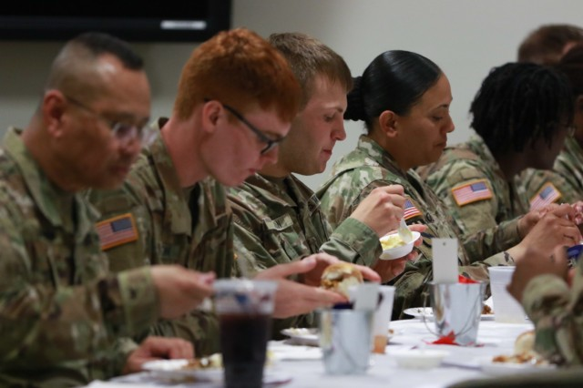 Soldiers enjoy a meal during the National Day of Prayer luncheon at U.S. Army Central headquarters on Shaw Air Force Base, S.C., May 2, 2019. (U.S. Army photo by Sgt. Von Marie Donato)