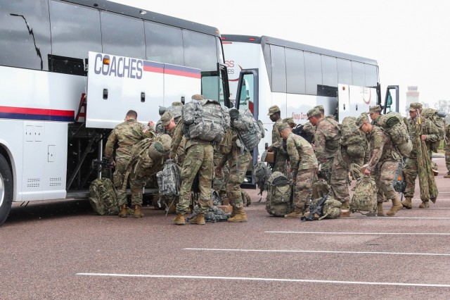 U.S. Army Soldiers assigned to 2nd Battalion, 12th Infantry Regiment, 2nd Infantry Brigade Combat Team, 4th Infantry Division, load their bags under a bus, May 9, 2019, as they prepare to depart Fort Carson, Colorado in support of Cadet Summer Training at Fort Knox, Kentucky. (U.S. Army photo by Staff Sgt. Neysa Canfield)