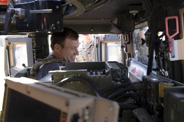 NASCAR driver Ryan Newman sits behind the wheel of a Humvee while visiting Fort Bragg, N.C., April 17, 2019.
