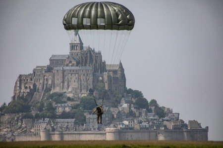 A paratrooper assigned to the U.S. Army's 10th Special Forces Group (Airborne) conducts an airborne operation near the island of Mont Saint Michel, Avranches, France on May 18, 2019. This event comes at the invitation of the Mayor of Avranches in commemoration of World War ll special operations that laid the success for the Allied liberation of France, and a celebration of the strong Alliance between France and the United States.