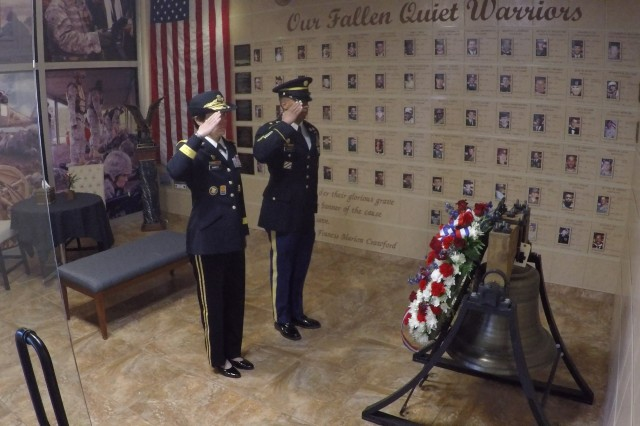 NETCOM Commanding General, Maj. Gen. Maria Barrett (left) and NETCOM G3 Sergeant Major, Sgt. Maj. Luis Matias, render honors after placing a memorial wreath inside the Signal Cove of Remembrance, during a memorial ceremony, May 22, inside the command headquarters, Fort Huachuca, Ariz.