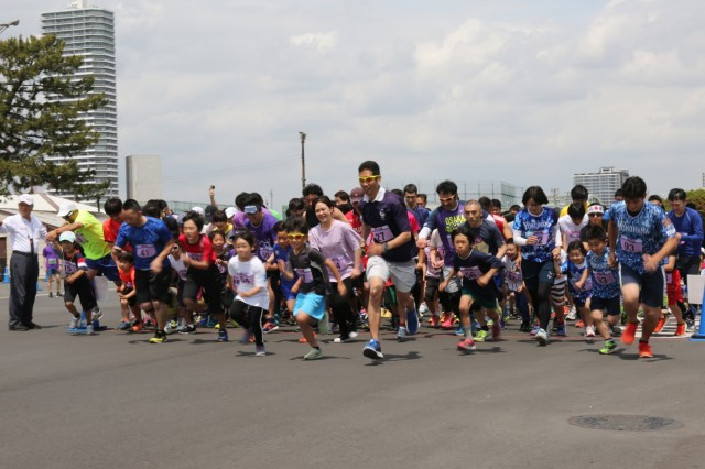 Runners take off at the start of the Yokohama North Dock Running Festival May 18, which Whittacre's unit hosted along with Camp Zama's Family, Morale, Welfare and Recreation.