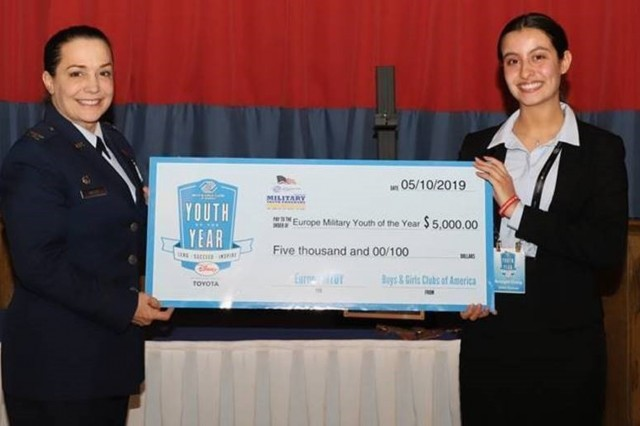 Vicenza High School student Bridget Craig is presented a scholarship check as the 2019 Europe Military Youth of the Year from U.S. Air Force Col. Carol J. Miller, Commander of the 100th Mission Support Group, Royal Air Force Mildenhall, England.  Craig was selected from 18 students in the competition (Contributed photo)