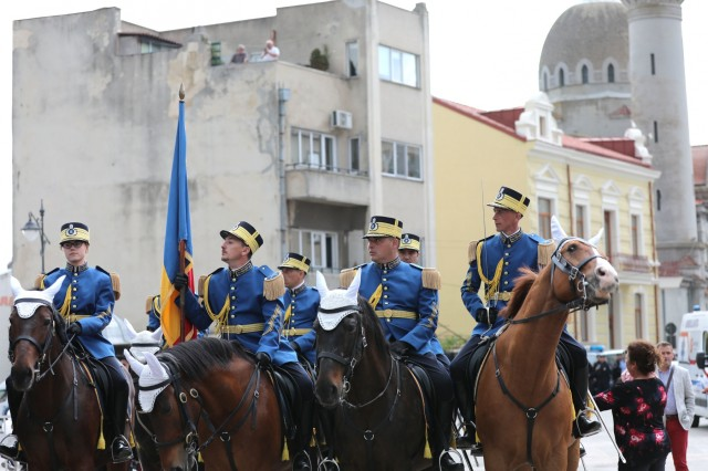 Romanian mounted security personnel ride into the city square in a parade and celebration in Constanta, Romania May 21, 2019. In addition to celebrating the beginning of summer, the annual parade honors the local police force. (U.S. Army photo by Sgt. Erica Earl).