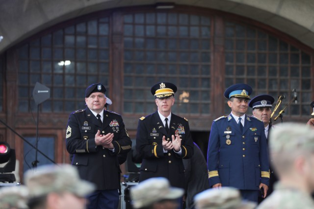 Col. Dale Murray, Area Support Group Black Sea Commander (center) and Master Sgt. Brian Breaker (left), acting sergeant major for ASG-BS, applaud at a parade and celebration in Constanta, Romania May 21, 2019. The annual parade celebrates many things, including the start of summer and seasonal sports. (U.S. Army photo by Sgt. Erica Earl).
