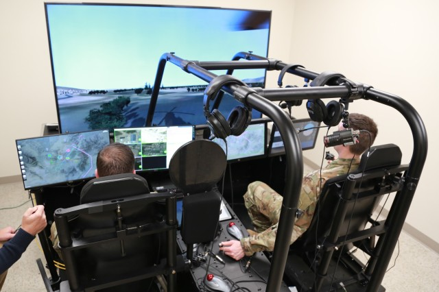 Soldiers use the Future Open Rotorcraft Cockpit Environment, or FORCE, simulator during a demo day in Huntsville, Alabama, Feb. 28. FORCE is a reconfigurable, extensible and portable platform that provides readiness to the U.S. Army by enabling innovative technology evaluation through rapid integration timelines.