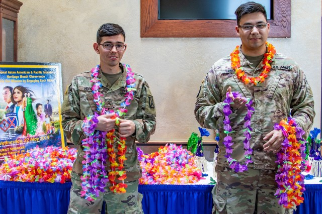 Soldiers with 1st Battalion, 32nd Infantry Regiment, 1st Brigade Combat Team, 10th Mountain Division, hand out traditional Leis to attendees May 22 at the National Asian Americans and Pacific Islanders Heritage Observance at the Commons, hosted by 1st Brigade Combat Team, 10th Mountain Division. (Photo by Staff Sgt. James Avery, 1st Brigade Combat Team, 10th Mountain Division)