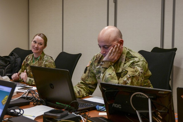 Maj. Christine Pierce, left, Pennsylvania cyber branch chief, works with branch senior noncommissioned officer Sgt. 1st Class Elefterios E. Ginnis May 21 at the Pennsylvania Emergency Management Agency (PEMA) to ensure the integrity and security of the commonwealth's primary elections.