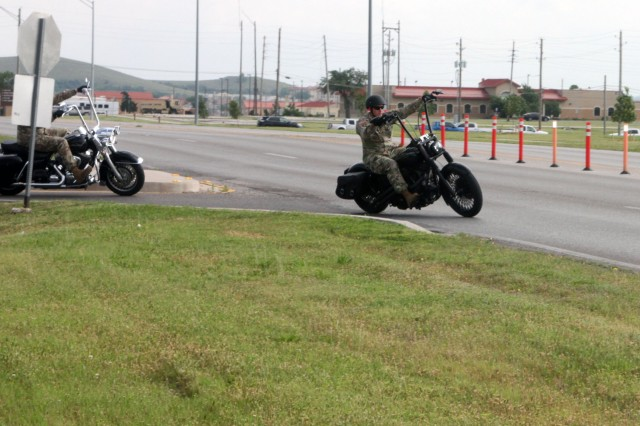 Motorcyclists taking part in Fort Sill's 14th Annual Freedom's Thunder Motorcycle Safety Rally roll out on their 40-mile jaunt through the Wichita Mountains Wildlife Refuge, Medicine Park, and back on post for a skill test at the Motorcycle Safety Foundation Course.