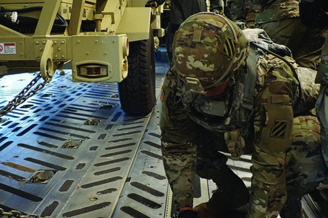 Soldiers from 414th Signal Company helps secure equipment on a C-17 during an emergency deployment exercise, May 14, on Fort Stewart's Wright Army Airfield.