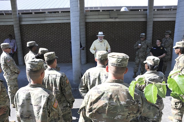 Fort Stewart-Hunter Army Airfield Directorate of Plans, Training, Mobilization and Security's Plans Chief Roy Lintz provides a safety overview to roll-players during a rehearsal, a day before an active-shooter response exercise, May 16.