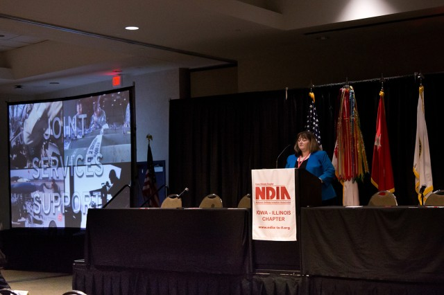 JoEtta Fisher, Joint Munitions Command Executive Director for Ammunition and Deputy to the Commander, discusses business opportunities to small business owners during the 2019 Midwest Small Business Symposium held May 22-23. (Photo by Courtney Maxson, JMC Public Affairs)