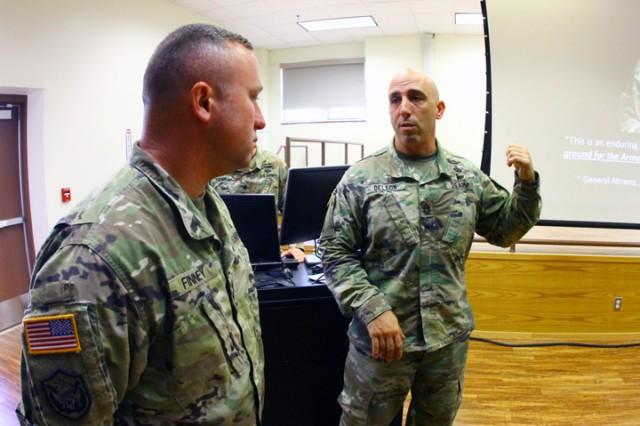 Master Sgt. Matthew De Leon, right, SFAB recruiting team NCOIC Fort Bragg, N.C., speaks with a Soldier about SFAB opportunities after a briefing May 16, 2019, at Burleson Hall.