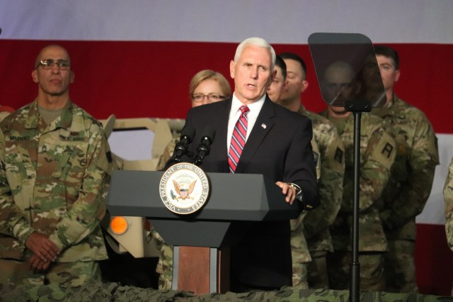 Vice President of the United States Mike Pence gives a speech during an official visit May 16, 2019, at Fort McCoy, Wis. During his stop at Fort McCoy, Pence learned about military equipment; met with hundreds of Fort McCoy workforce, military, and family members; and gave a speech at an Equipment Concentration Site-67 building. (U.S. Army Photo by Scott T. Sturkol, Public Affairs Office, Fort McCoy, Wis.)
