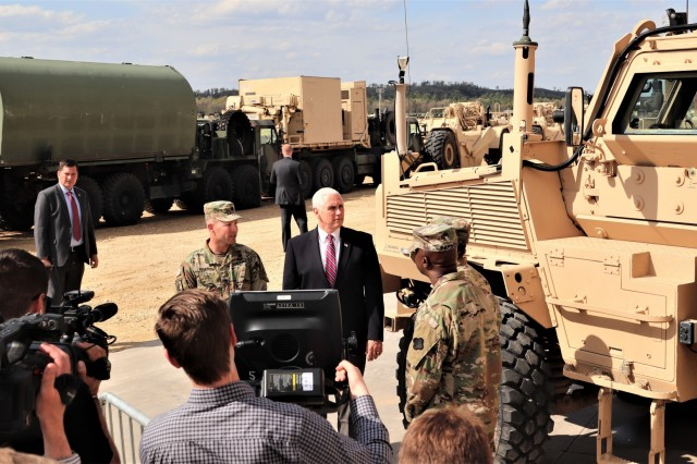 Vice President of the United States Mike Pence meets with Lt. Col. Charles Wells, commander of the 3rd Battalion, 340th Brigade Engineer Battalion, to learn about an RG33 Medium Mine-Protected Vehicle during an official visit by the vice president May 16, 2019, at Fort McCoy, Wis. During his stop at Fort McCoy, Pence learned about military equipment; met with hundreds of Fort McCoy workforce, military, and family members; and gave a speech at an Equipment Concentration Site-67 building. (U.S. Army Photo by Scott T. Sturkol, Public Affairs Office, Fort McCoy, Wis.)