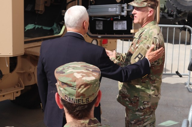 Vice President of the United States Mike Pence meets with Command Sgt. Maj. Rathe Thompson, command sergeant major of the 3rd Battalion, 340th Brigade Engineer Battalion, to learn about an RG33 Medium Mine-Protected Vehicle during an official visit by the vice president May 16, 2019, at Fort McCoy, Wis. During his stop at Fort McCoy, Pence learned about military equipment; met with hundreds of Fort McCoy workforce, military, and family members; and gave a speech at an Equipment Concentration Site-67 building. (U.S. Army Photo by Scott T. Sturkol, Public Affairs Office, Fort McCoy, Wis.)
