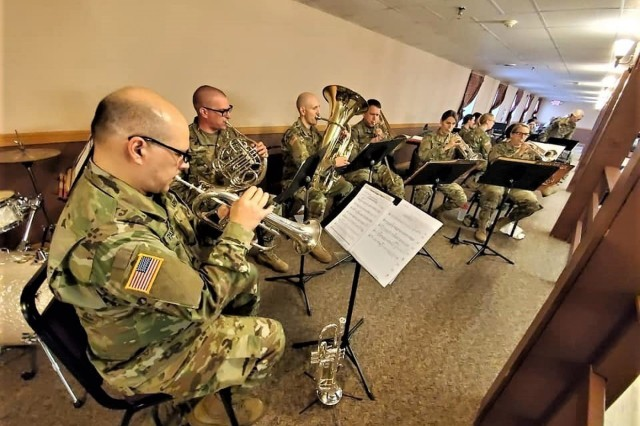 Members of the 204th Army Band of Fort Snelling, Minn., play a song in building 905 on May 18, 2019, during the 2019 Armed Forces Day Open House at Fort McCoy, Wis. Thousands of people attended the event that included bus tours of the installation, camouflage face painting, a display of native animals by the Fort McCoy Directorate of Public Works Environmental Division Natural Resources Branch, military vehicles and equipment, and unit and tenant organization displays. The post holds the open house every year on Armed Forces Day - the third Saturday of May. (U.S. Army Photo by Scott T. Sturkol, Public Affairs Office, Fort McCoy, Wis.)