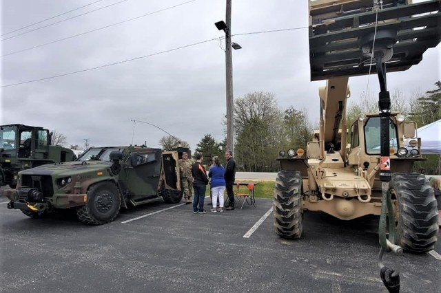 Visitors to the 2019 Fort McCoy Armed Forces Day Open House walk around the displays outside of building 905 on May 18, 2019, at Fort McCoy, Wis. Thousands of people attended the event that included bus tours of the installation, camouflage face painting, a display of native animals by the Fort McCoy Directorate of Public Works Environmental Division Natural Resources Branch, military vehicles and equipment, and unit and tenant organization displays. The post holds the open house every year on Armed Forces Day - the third Saturday of May. (U.S. Army Photo by Scott T. Sturkol, Public Affairs Office, Fort McCoy, Wis.)