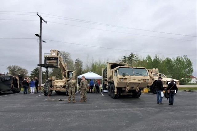Visitors to the 2019 Fort McCoy Armed Forces Day Open House look over outdoor displays May 18, 2019, at Fort McCoy, Wis. Thousands of people attended the event that included bus tours of the installation, camouflage face painting, a display of native animals by the Fort McCoy Directorate of Public Works Environmental Division Natural Resources Branch, military vehicles and equipment, and unit and tenant organization displays. The post holds the open house every year on Armed Forces Day - the third Saturday of May. (U.S. Army Photo by Scott T. Sturkol, Public Affairs Office, Fort McCoy, Wis.)