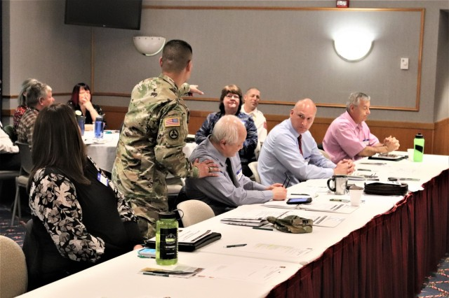 Fort McCoy, local, and state government personnel learn about intergovernmental and community partnerships during the Army Community Partnership Kick-off and Needs and Capacity Conference on April 25, 2019, at Fort McCoy, Wis. Leaders from throughout the Fort McCoy Garrison, tenant organizations, and local government agencies participated in the conference. The effort supports the Army Community Partnership Program at Fort McCoy, which leverages the strength of federal, state, and local governments to form partnerships that increase efficiencies and produce cost savings. More follow-up action is planned through this effort that may produce future intergovernmental support agreements. (U.S. Army Photo by Scott T. Sturkol, Public Affairs Office, Fort McCoy, Wis.)