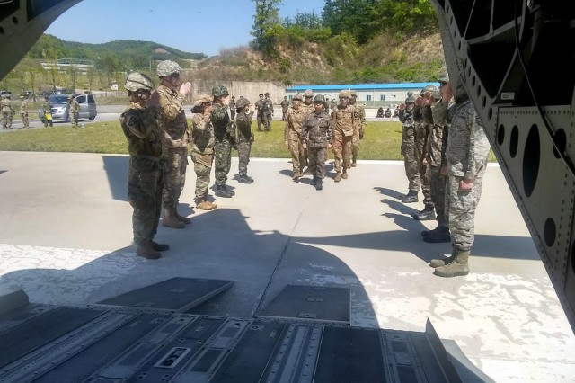 Religious support professionals from the U.S. Army, Air Force and ROK Army conduct a hasty ramp ceremony for notional fallen comrade at the ROK Army Special Warfare Center. ROK Army Chaplain, Maj. Myungshin Kim, proceeds with the honor detail.