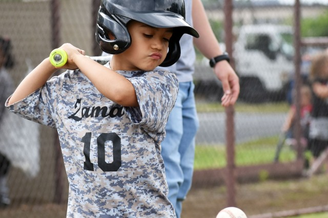 Nahum Giron, a player on the Camp Zama T-ball team, prepares to bat during a game at Camp Zama May 18.