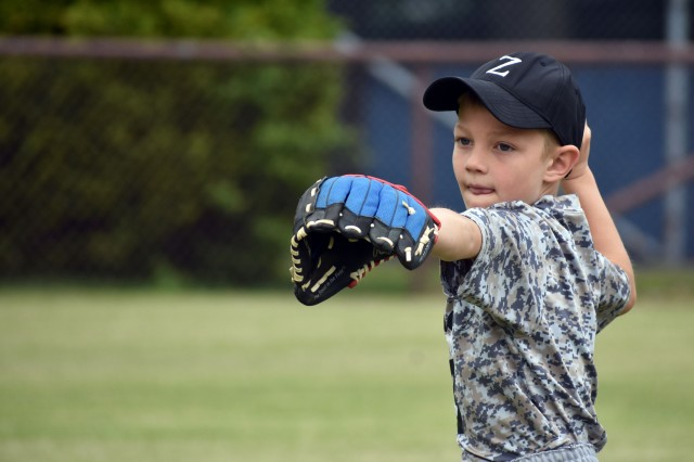 Carter Nelson, 6, warms up before a T-ball game at Camp Zama May 18.
