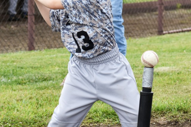 Hunter Padgett, 6, bats during a T-ball game at Camp Zama May 18.